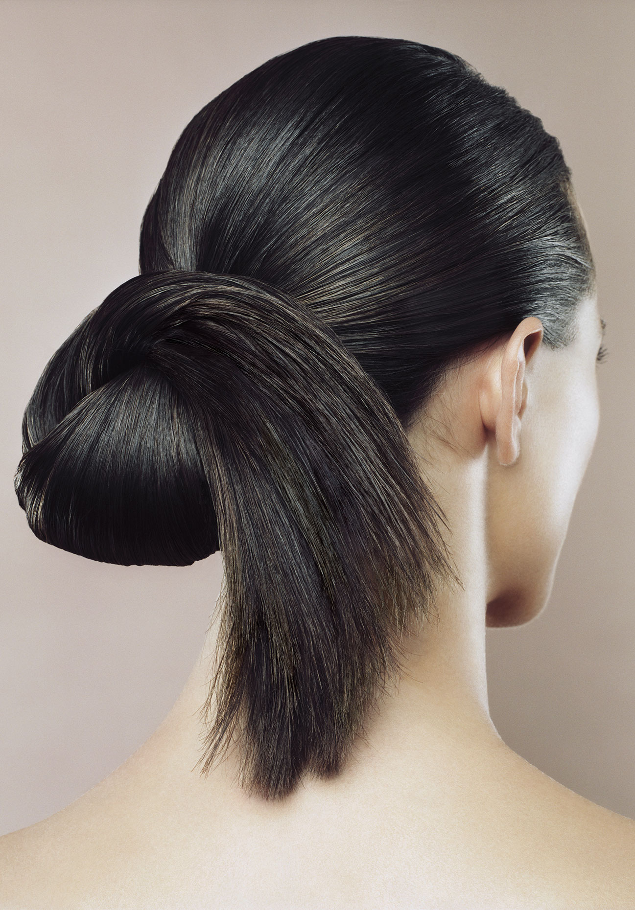 Woman with hair styled, rear view.