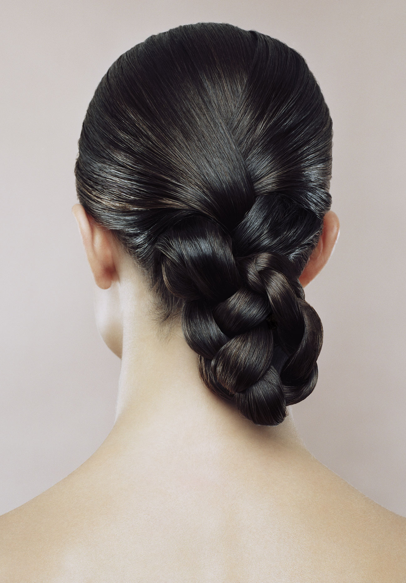 Woman with hair braided, rear view.