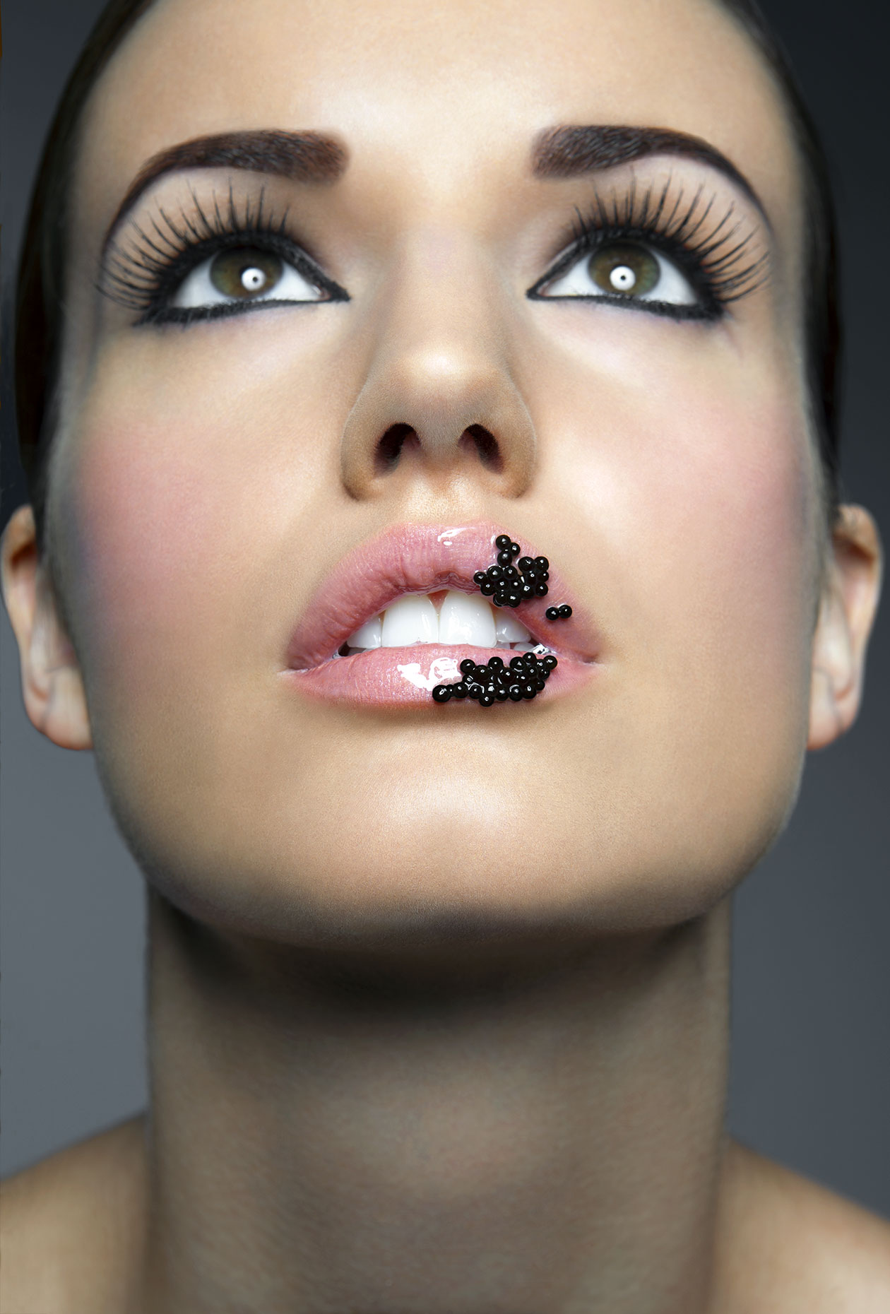 Young woman with caviar on her lips, close up.