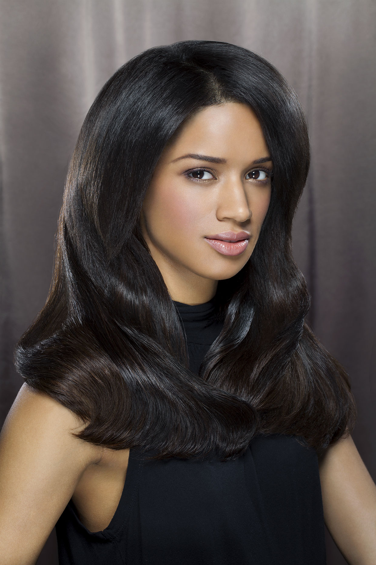 Young woman with shiny, luxurious hair.