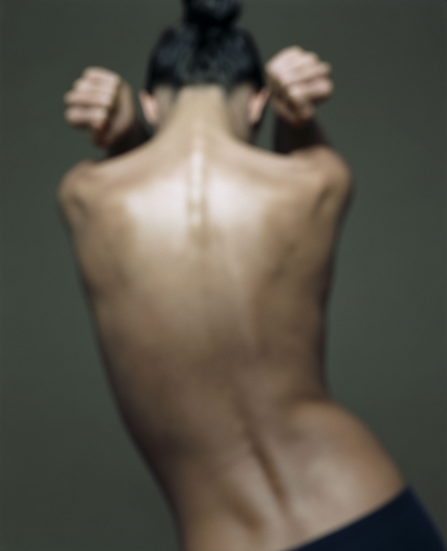 Naked young woman, rear view (defocused).