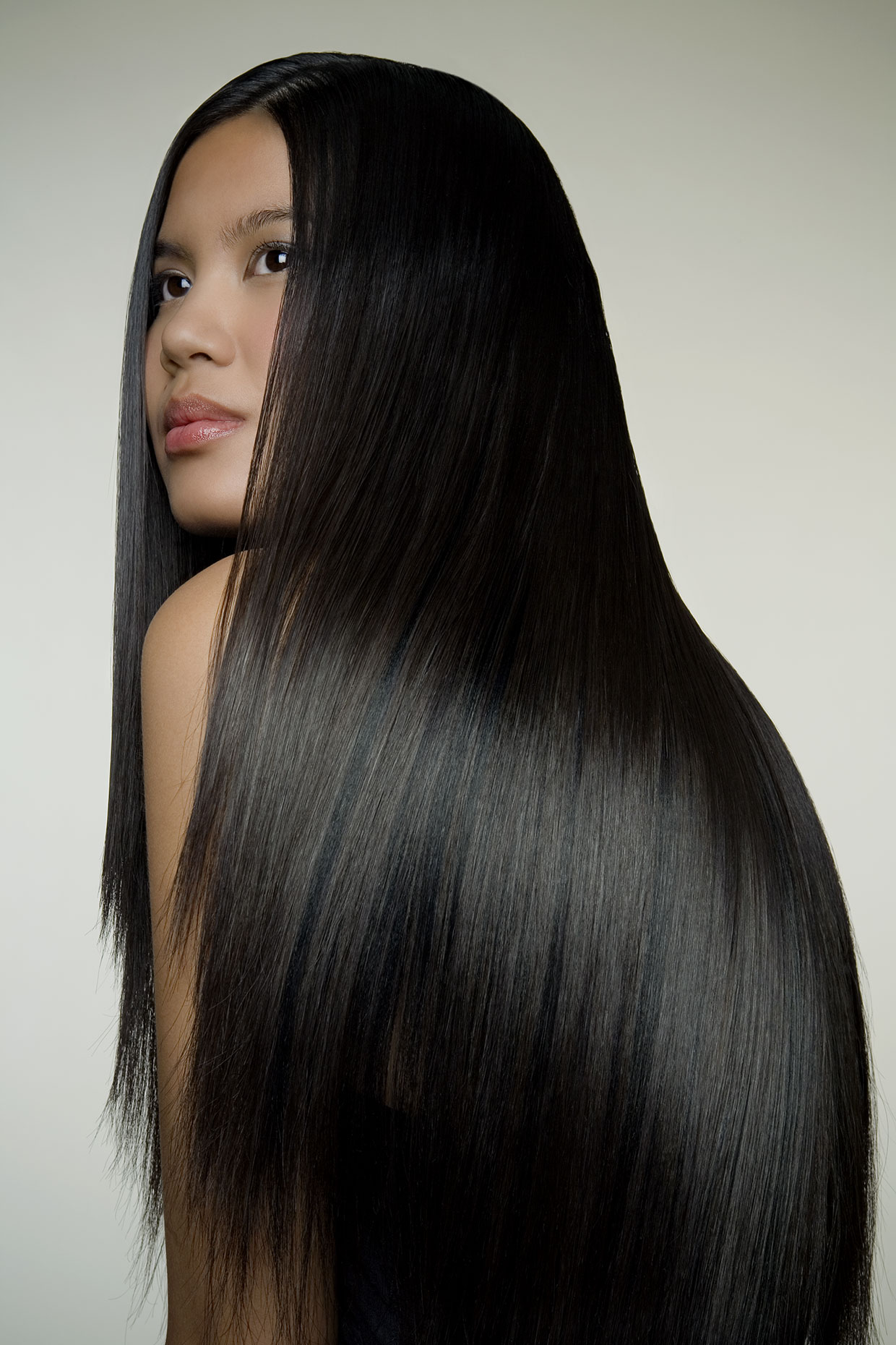 Asian woman with long shiny hair, profile.