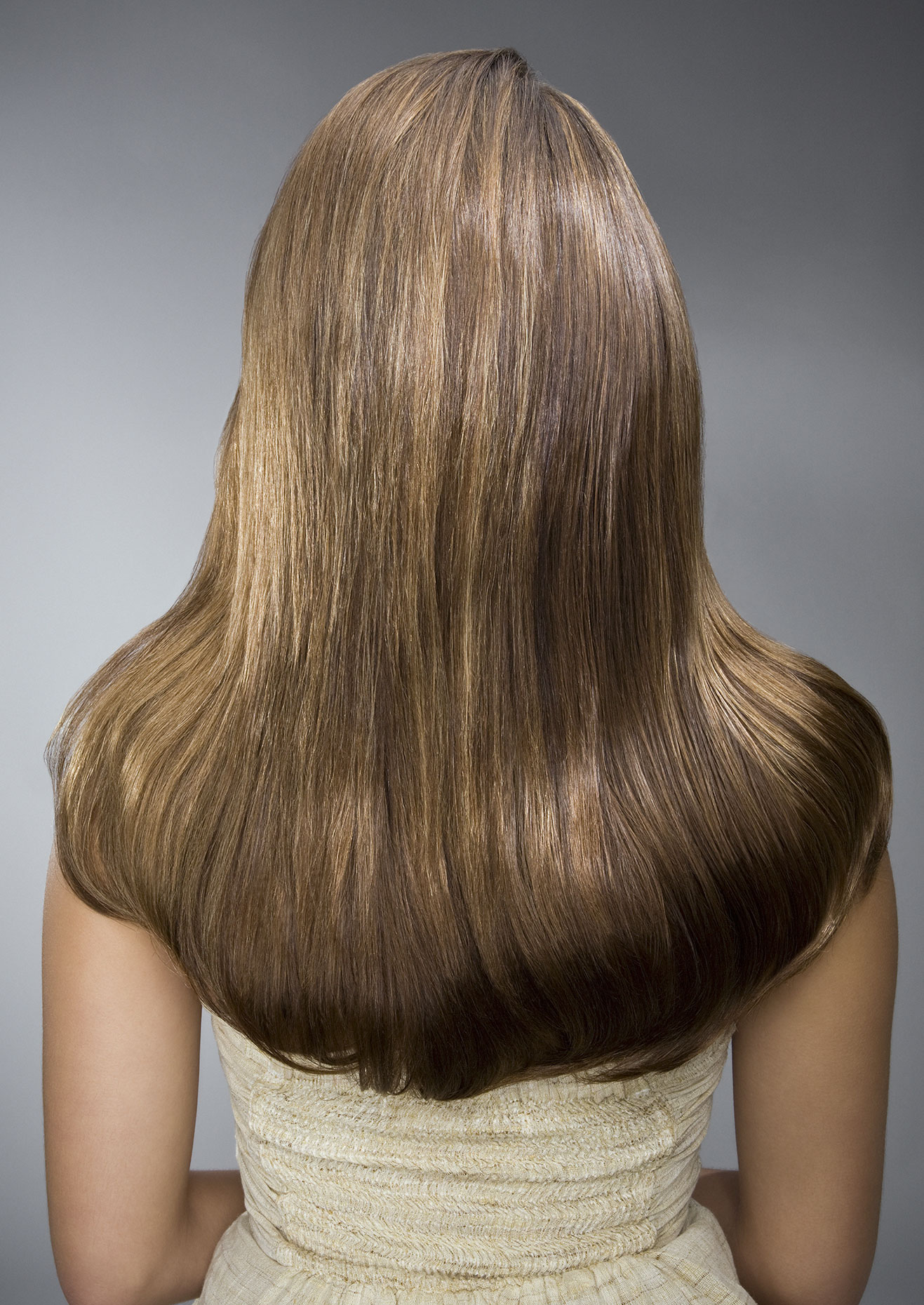 Young woman with shiny hair from the back.