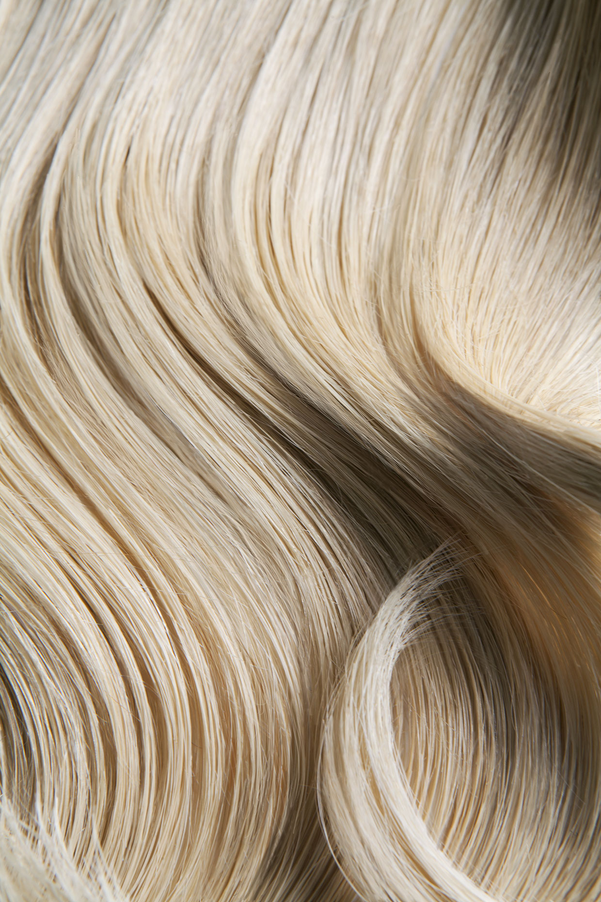 Close up shot of wavy blond hair.