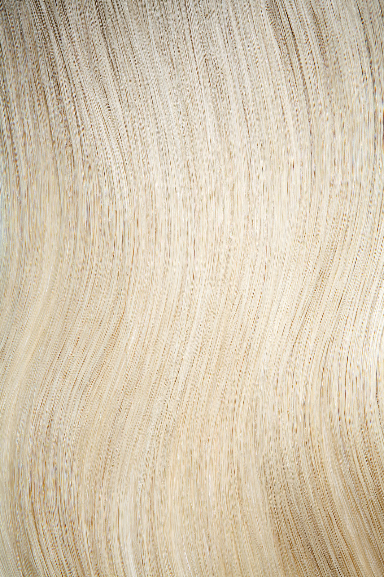 Tight shot of shiny blond hair.